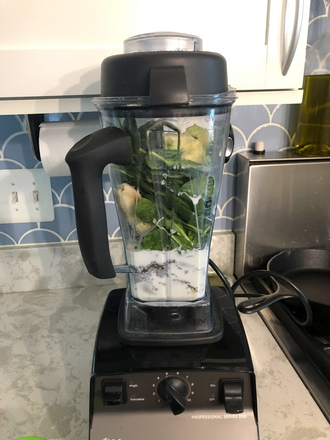 green smoothie with spinach, avocado, milk, chia seeds, banana