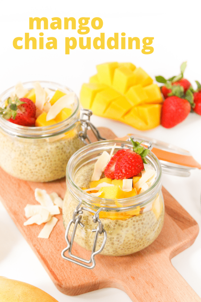mango chia pudding with coconut and strawberries in a jar