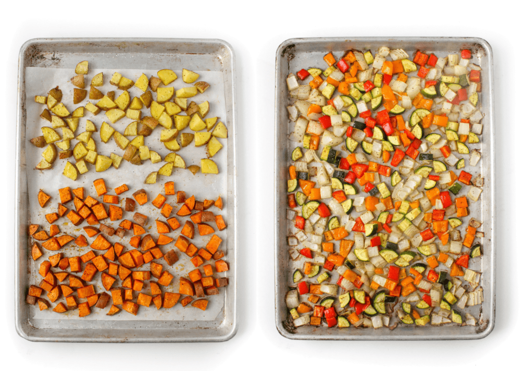 roasted sweet potato and vegetables on a sheet pan